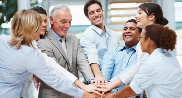 Diverse group of business team with hands together